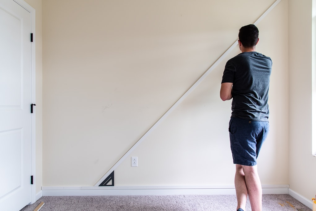 determining location of first piece using a speed square on the modern accent wall