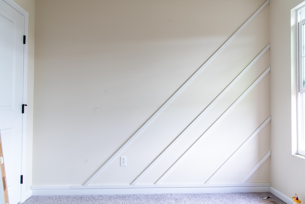 installing diagonal pieces for a modern accent wall