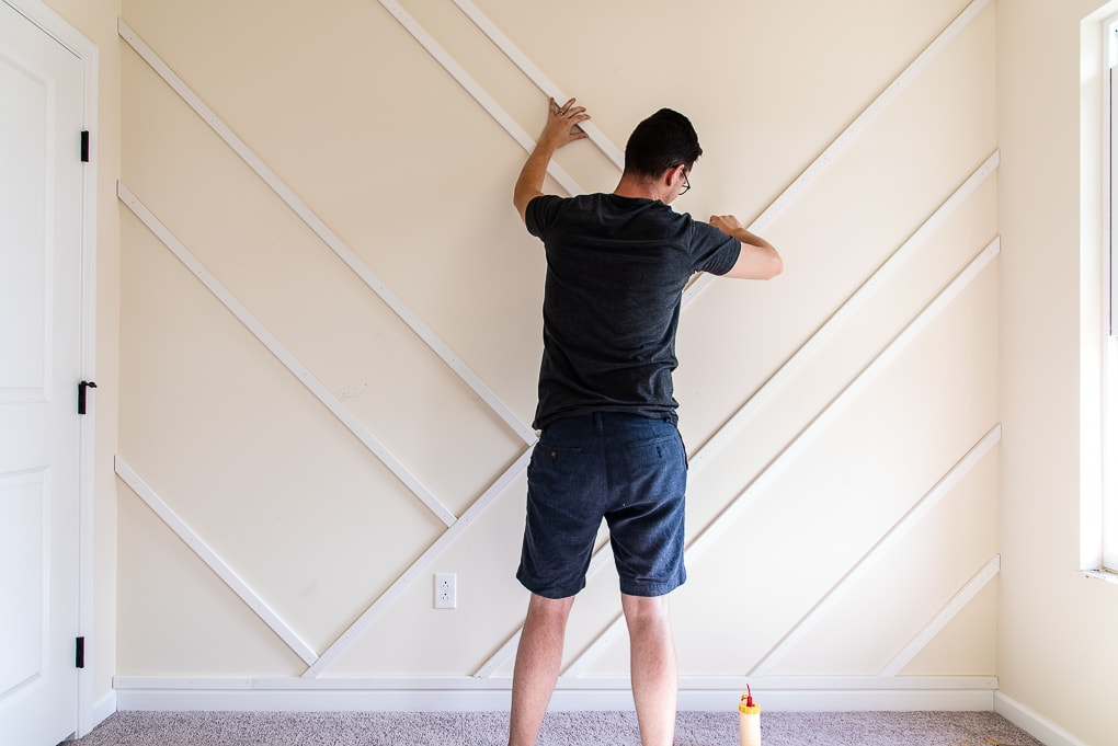 attaching wood to the wall for a modern accent wall