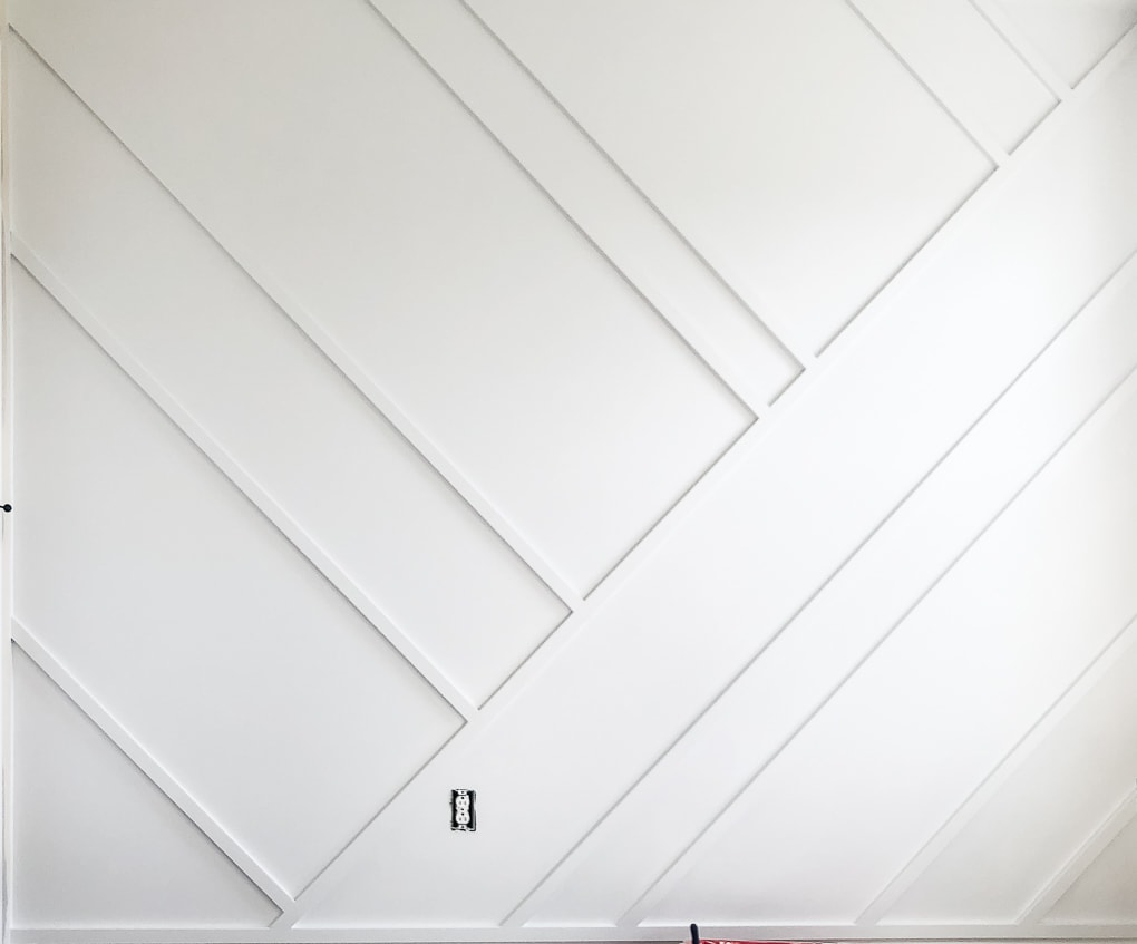 white modern accent wall in nursery