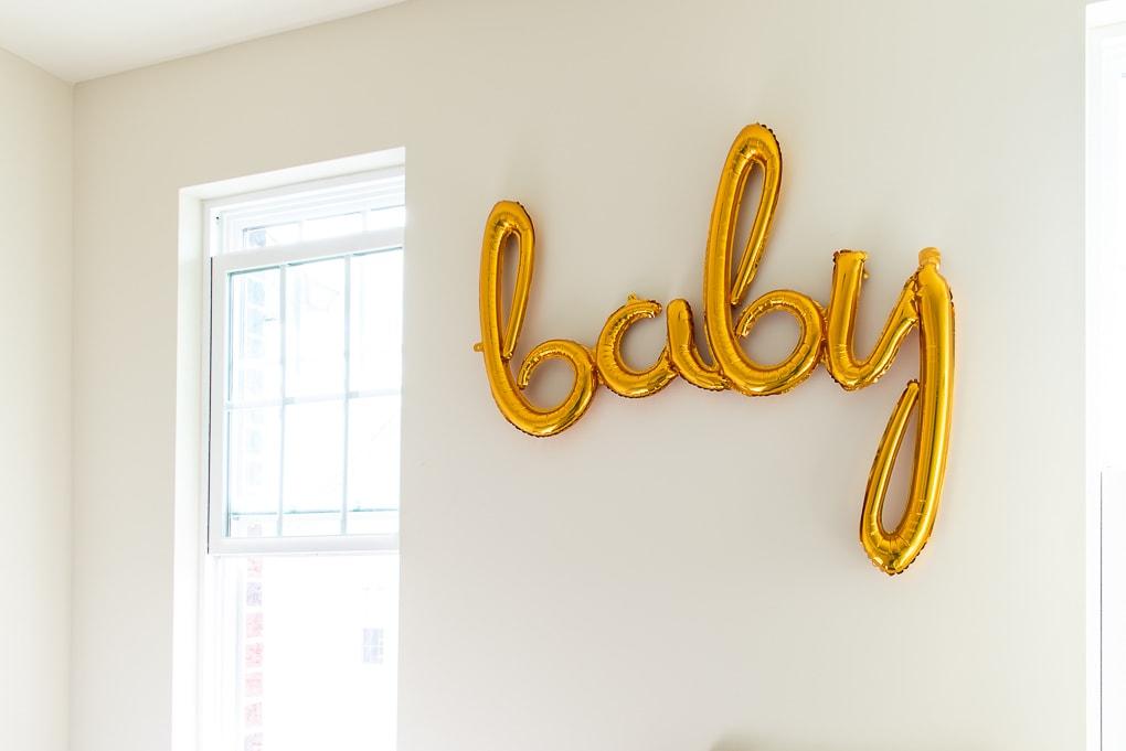gold baby balloon in a nursery