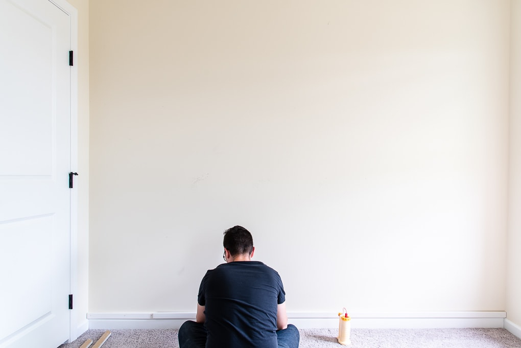 attaching the base piece with wood glue to the modern accent wall