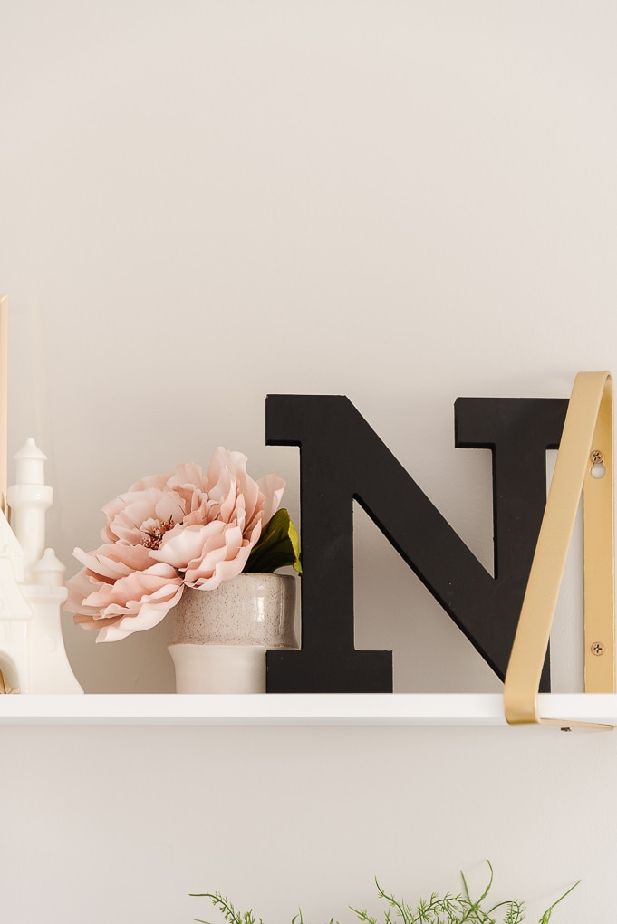 wooden letter N in a modern nursery for a baby girl