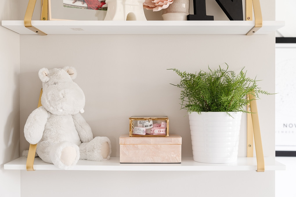 nursery decorative shelves close up detail of stuffed animal and small trinkets