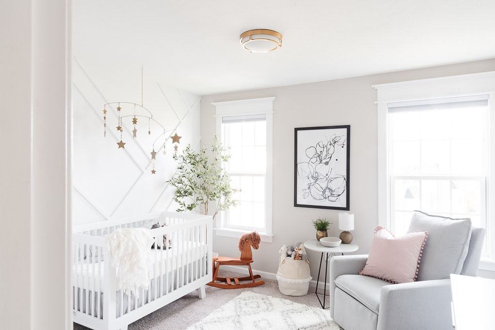 whole room view of modern neutral feminine nursery