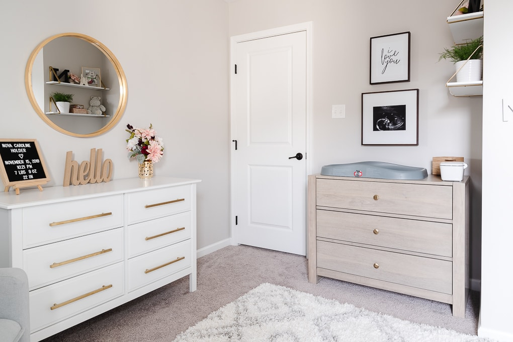 white and gray wash wooden dressers in a nursery with accessories