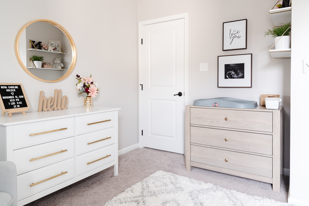 white and gray wash wooden dressers in a nursery