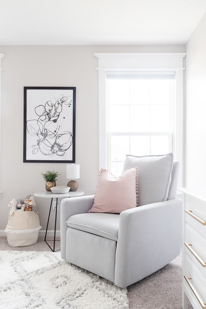 paxton glider from west elm in neutral nursery with modern black and white art