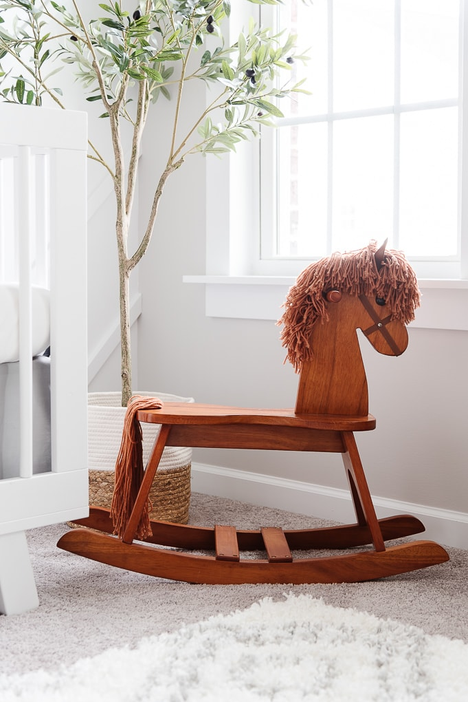 brown baby rocking horse in a nursery
