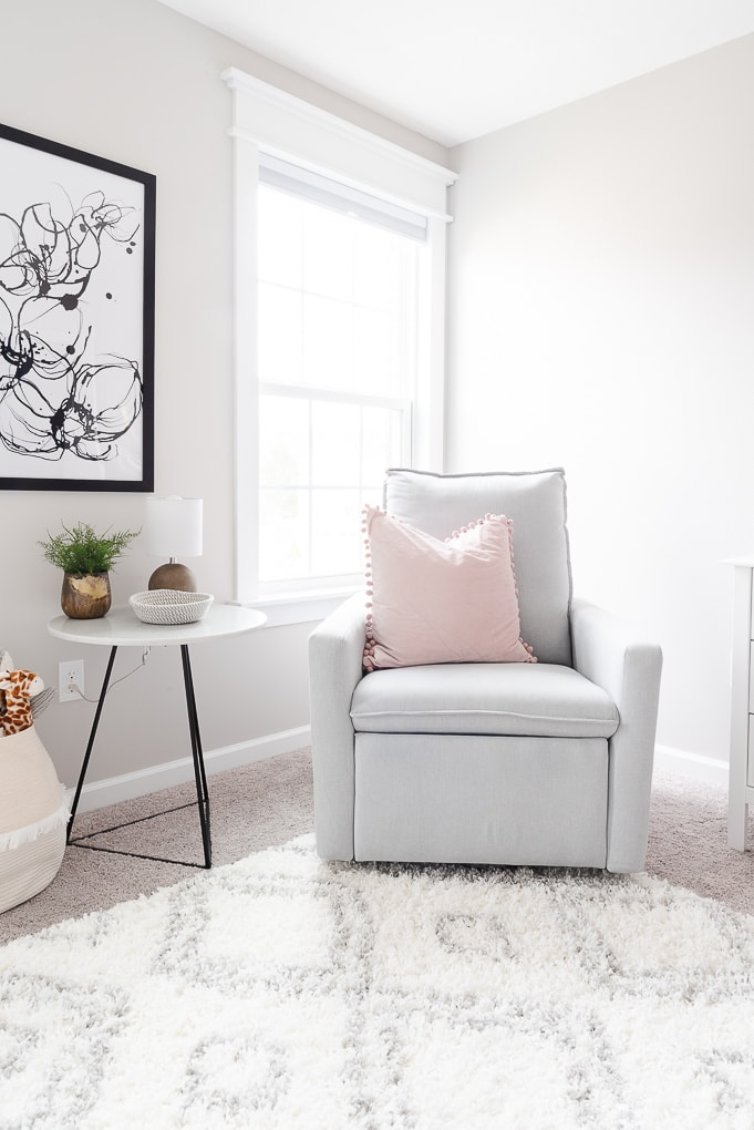 paxton glider chair in gray in a nursery