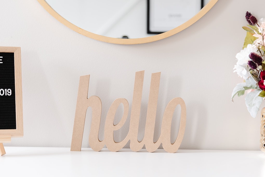 wooden decorative hello on a dresser