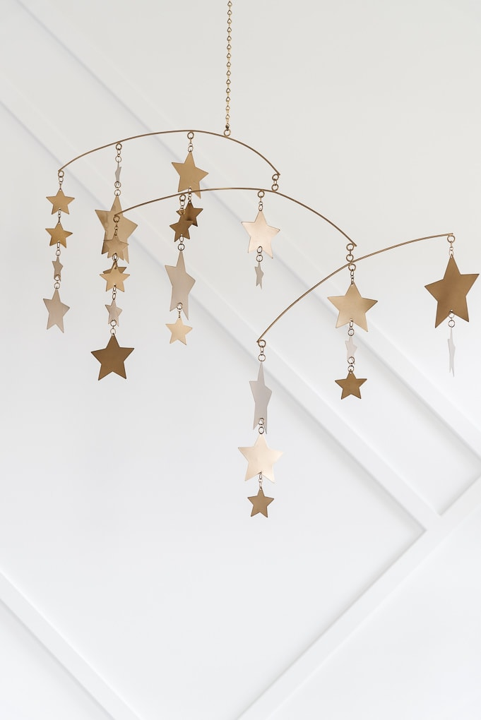 gold star mobile over crib from pottery barn kids in a modern neutral nursery