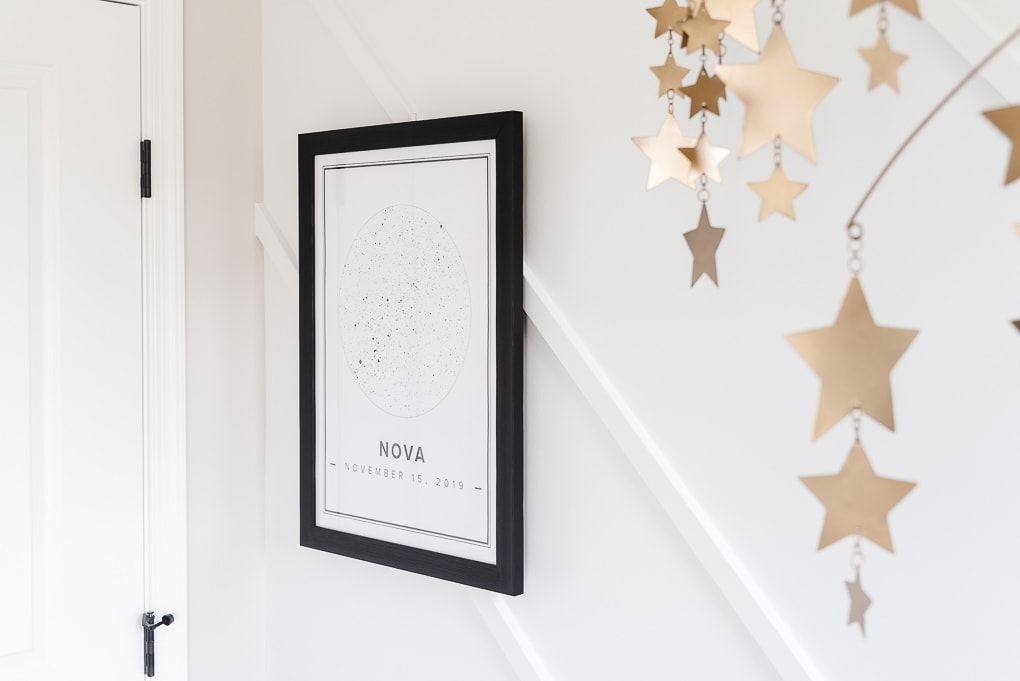 black and white star print from Mapiful against a modern accent wall