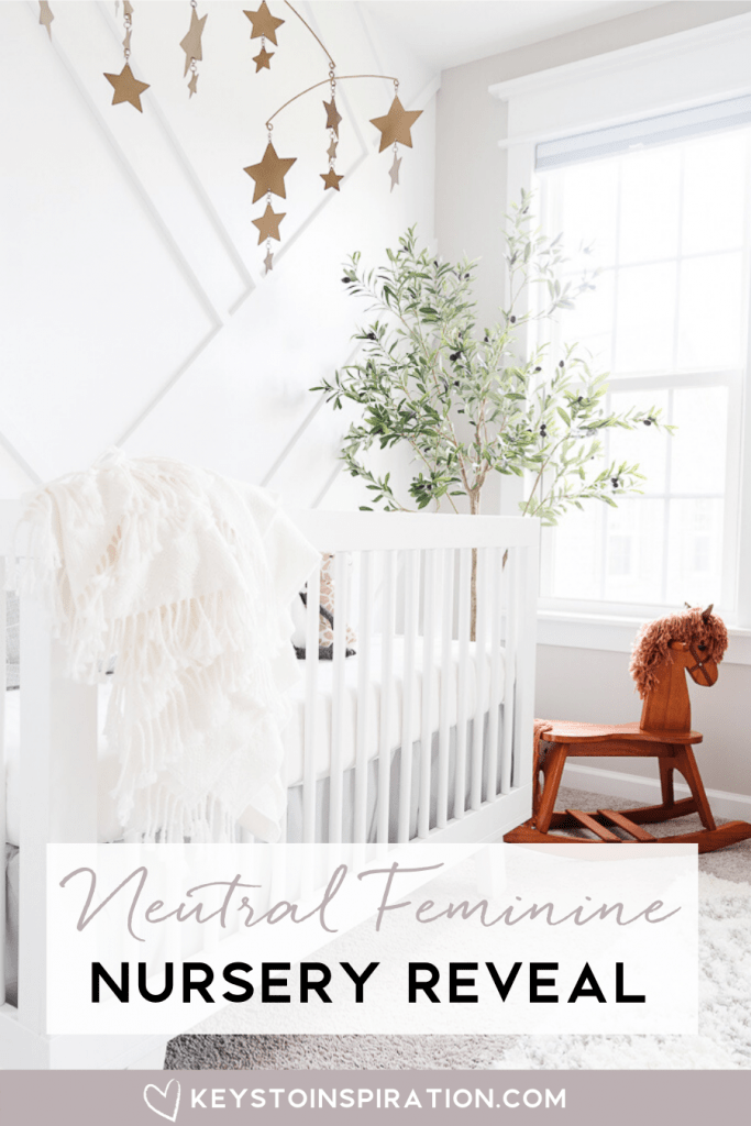 neutral feminine nursery reveal white crib against accent wall