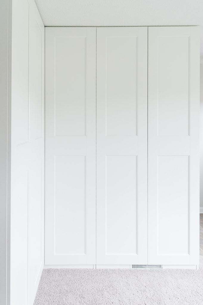 White IKEA PAX built-in storage cabinets