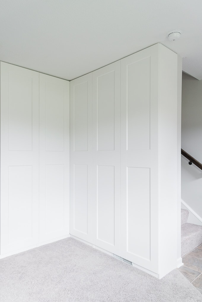 white IKEA PAX wardrobe unit corner GRIMO doors