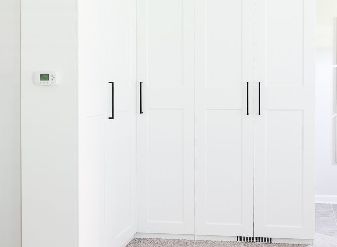 White IKEA PAX Wardrobe Cabinets with black hardware