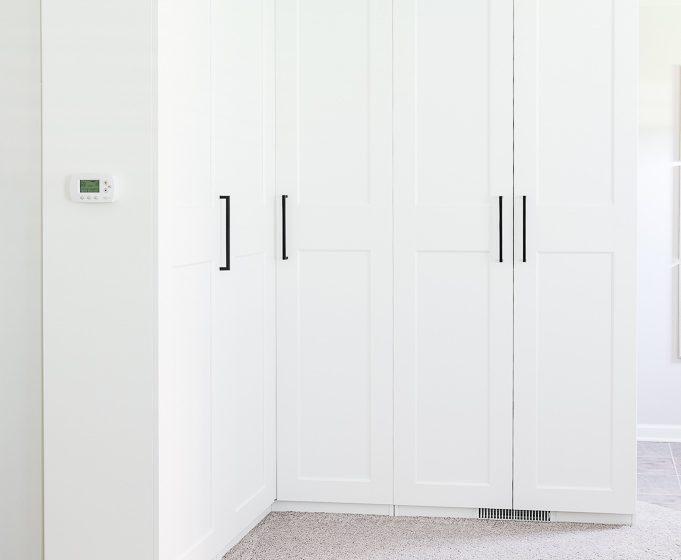 White IKEA PAX Wardrobe Cabinets with black hardware