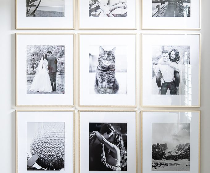 gold frames with black and white photos gallery wall