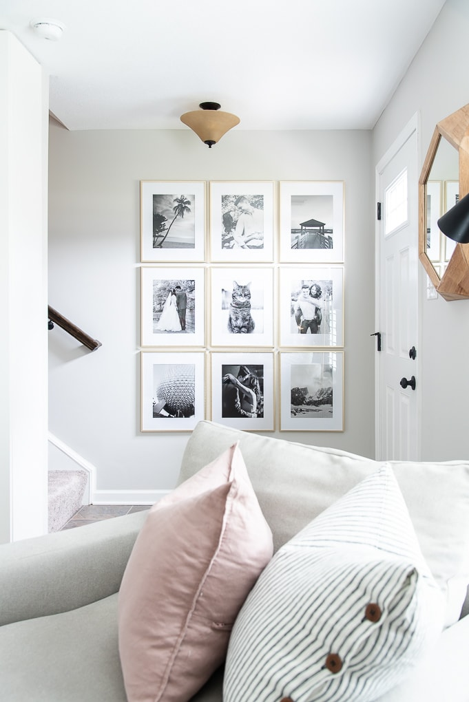 gold frames with black and white photos modern gallery wall entryway