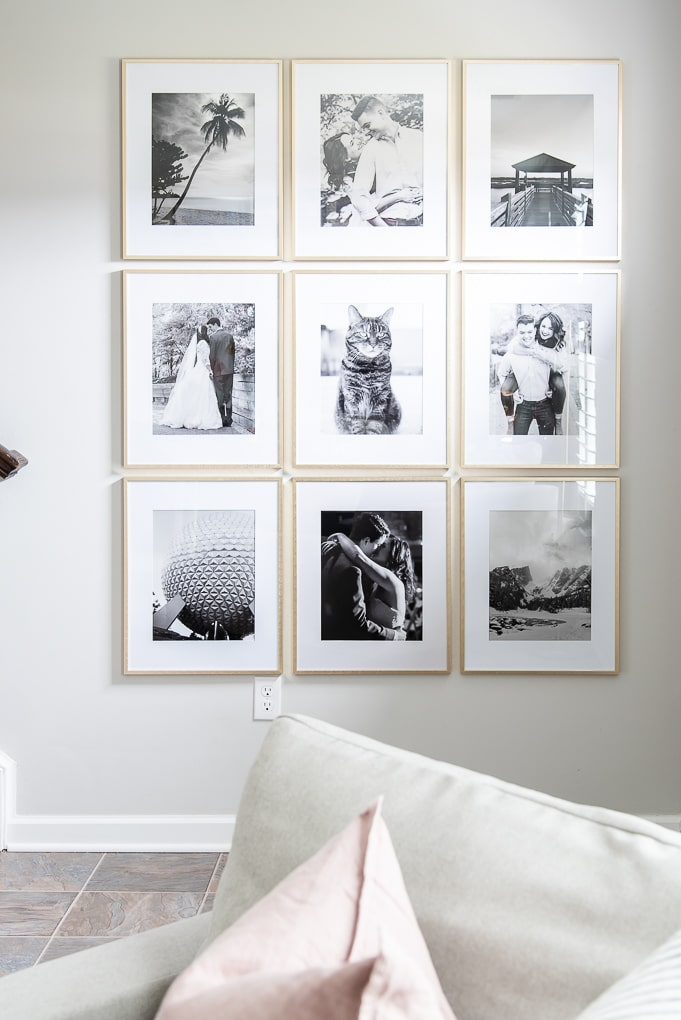 modern gallery wall gold frames with black and white family photos