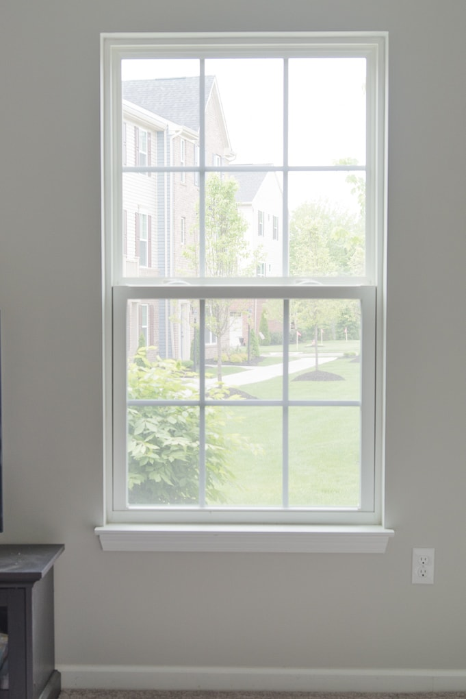 blank empty window without any window treatments new home construction
