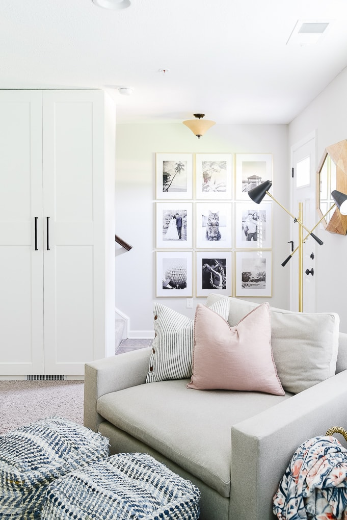 black and white gallery wall with gold frames in entry