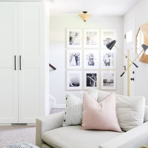 gold and black and white gallery wall in entryway