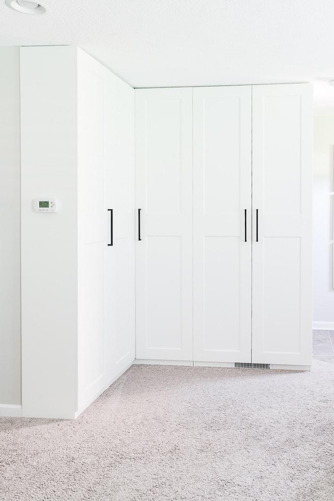 white IKEA PAX cabinets in corner