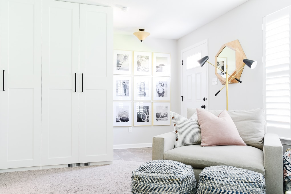 comfortable home office with storage cabinets and accent chair