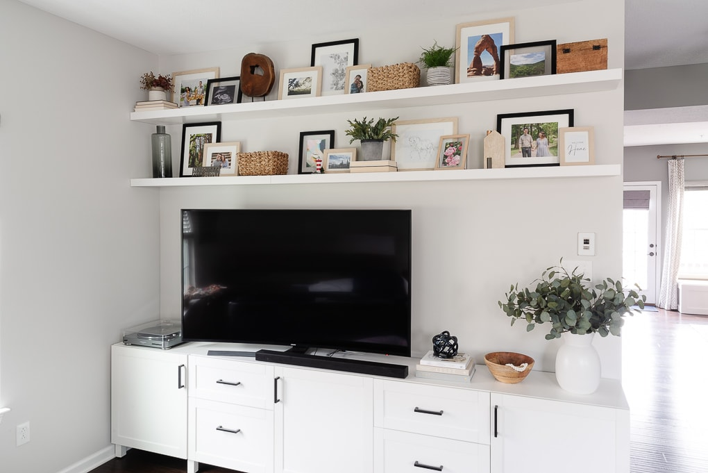 decorated IKEA LACK shelves with framed family photos