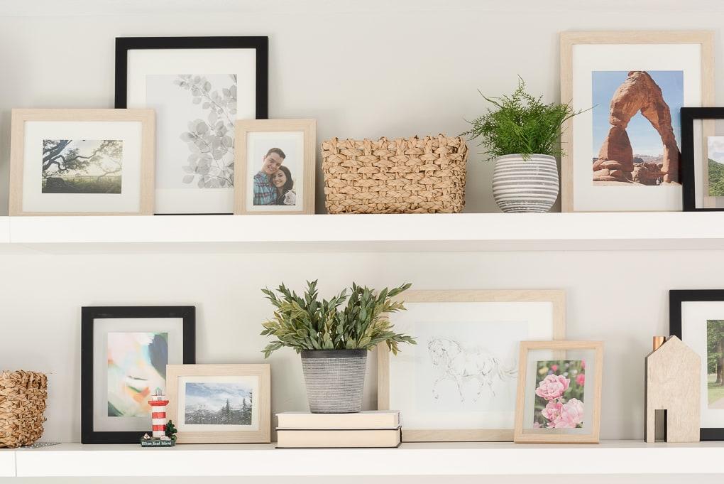 family photos printed in frames on shelves