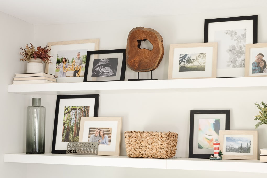 decorated shelves with printed and framed family photos