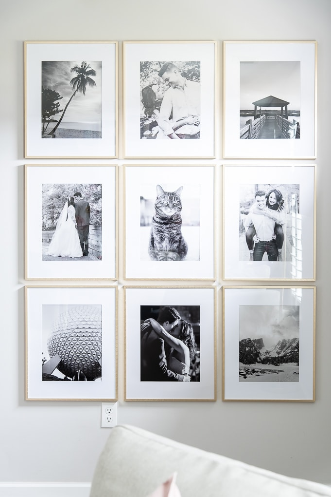 framed family photos in black and white in gallery wall