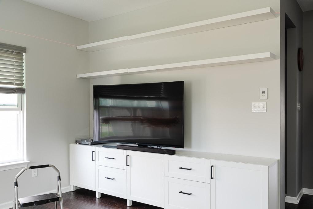 two IKEA LACK floating shelves over a tv media center