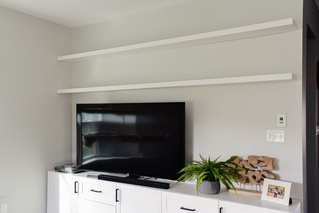 floating shelves above tv in living room