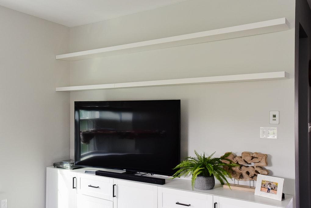 white IKEA LACK floating shelves in living room