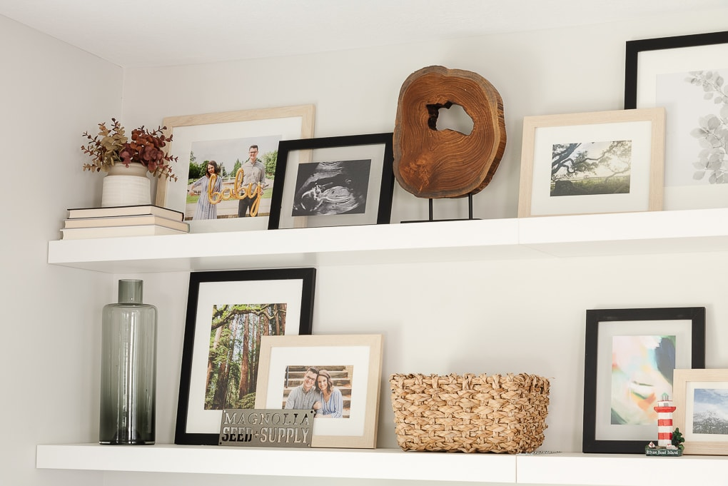 decorated IKEA LACK floating shelves in living room with family photos framed