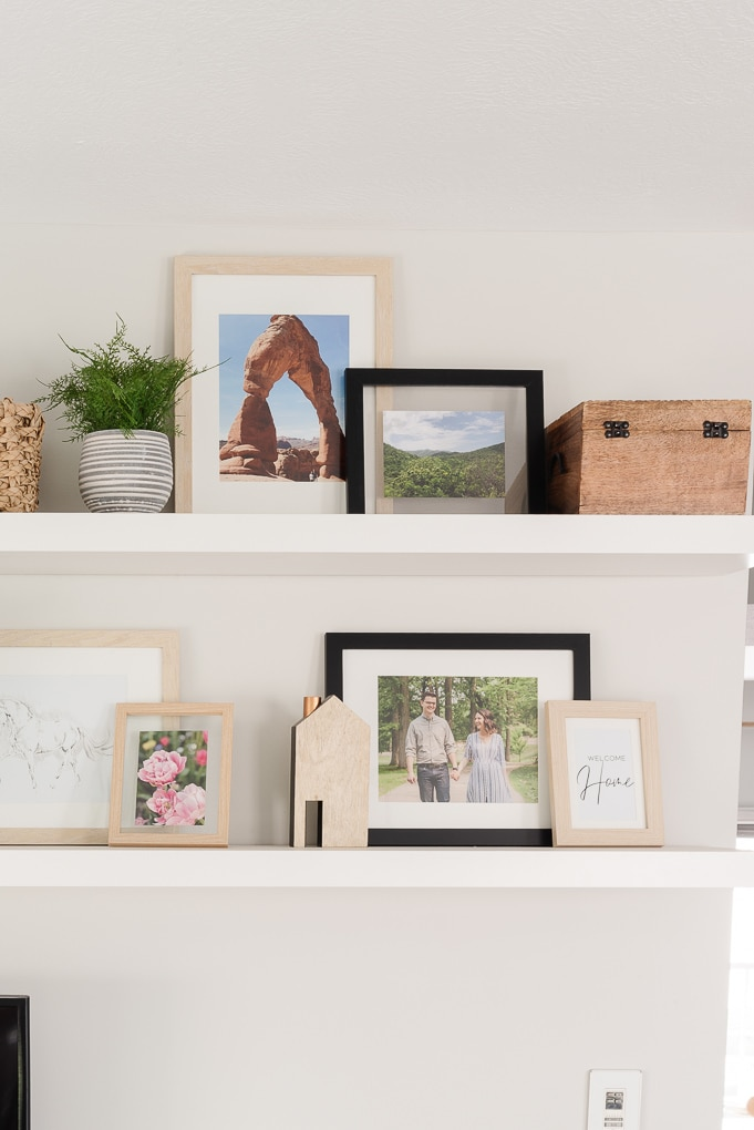 decorated IKEA LACK floating shelves with picture frames