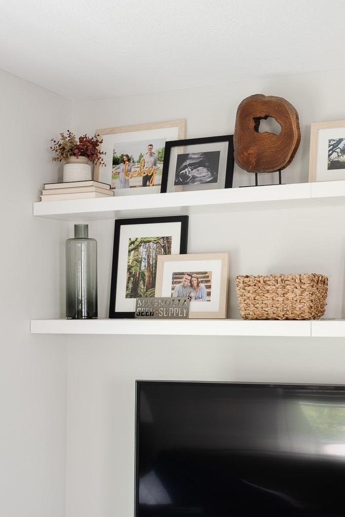 decorated floating shelves in living room