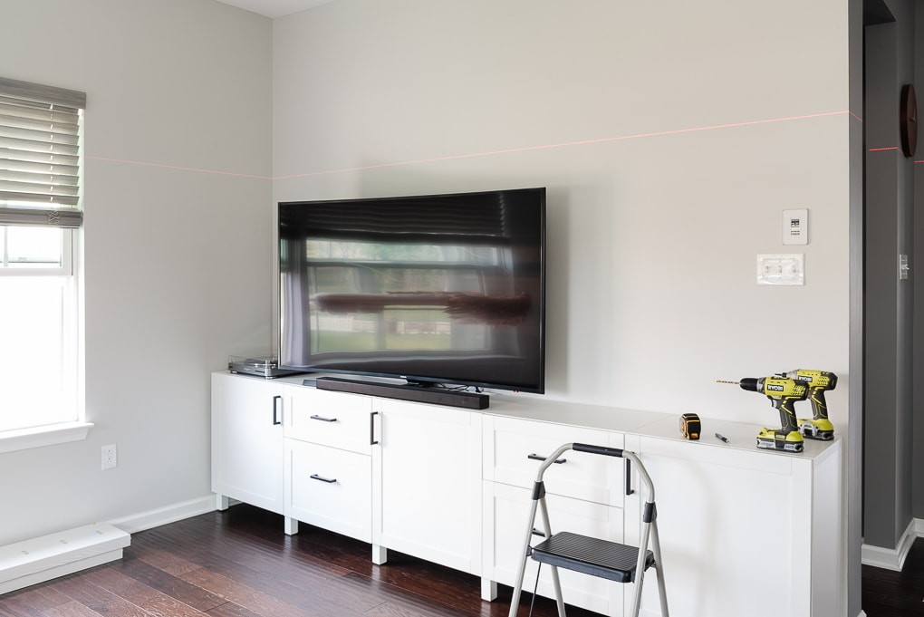 laser level line on tv wall in living room