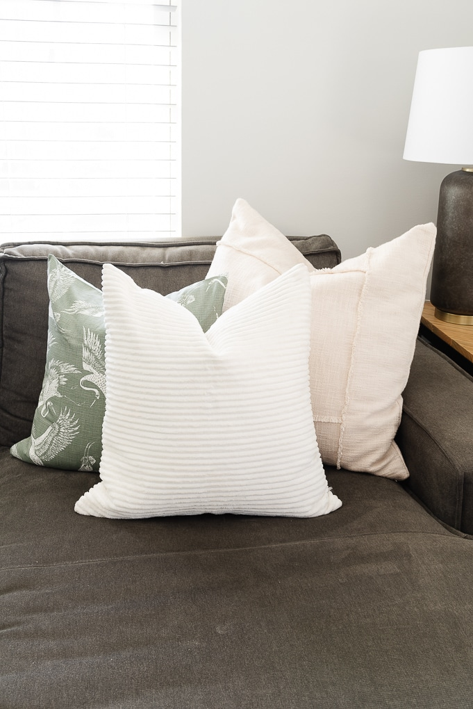 fall pillow trio on modern gray couch