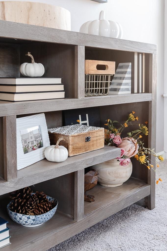 fall shelves decor with white mini pumpkin