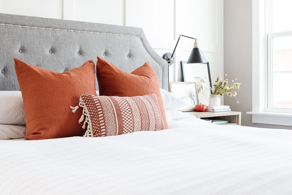fall master bedroom decor burnt orange pillows