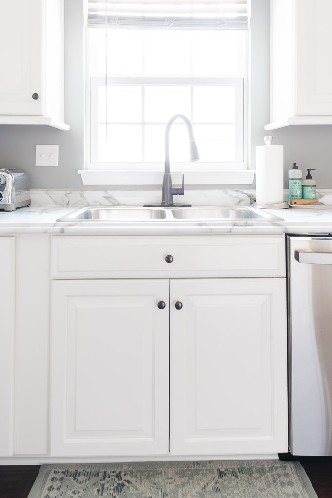 white kitchen sink and counter