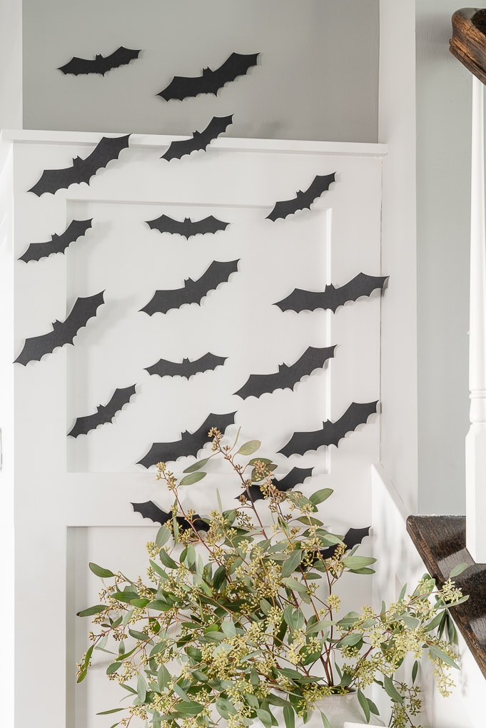 black halloween paper bats decor on white wall