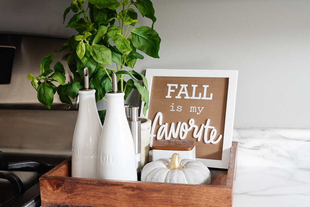 autumn kitchen tray with oil and vinegar containers and fall sign