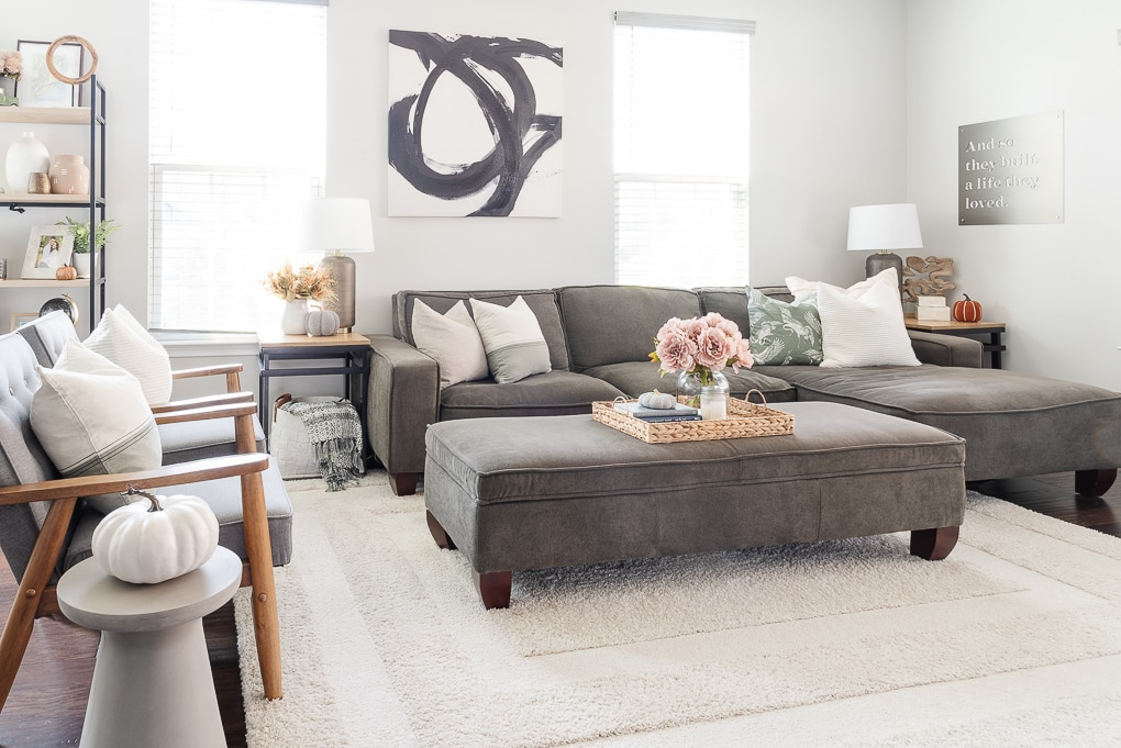 fall living room with gray couch and decor