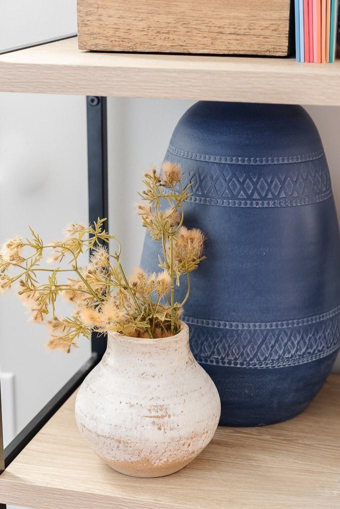 fall textured floral stems in vintage vase