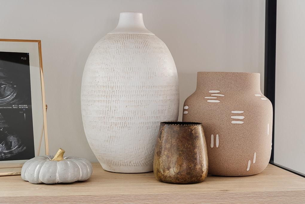 fall vases on bookshelf